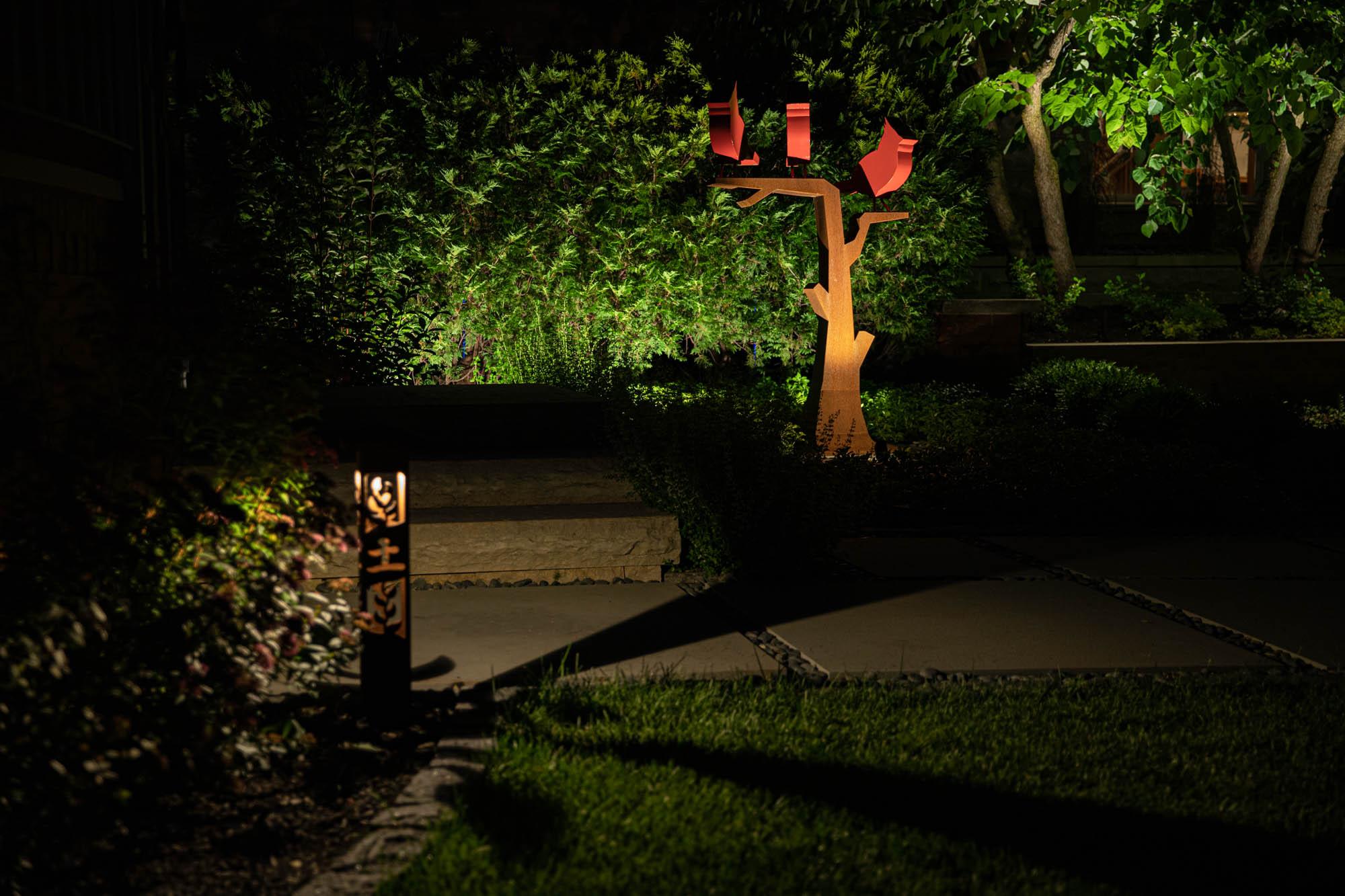 brookfield landscape lighting night owl outdoor decorative art corten steel statuary