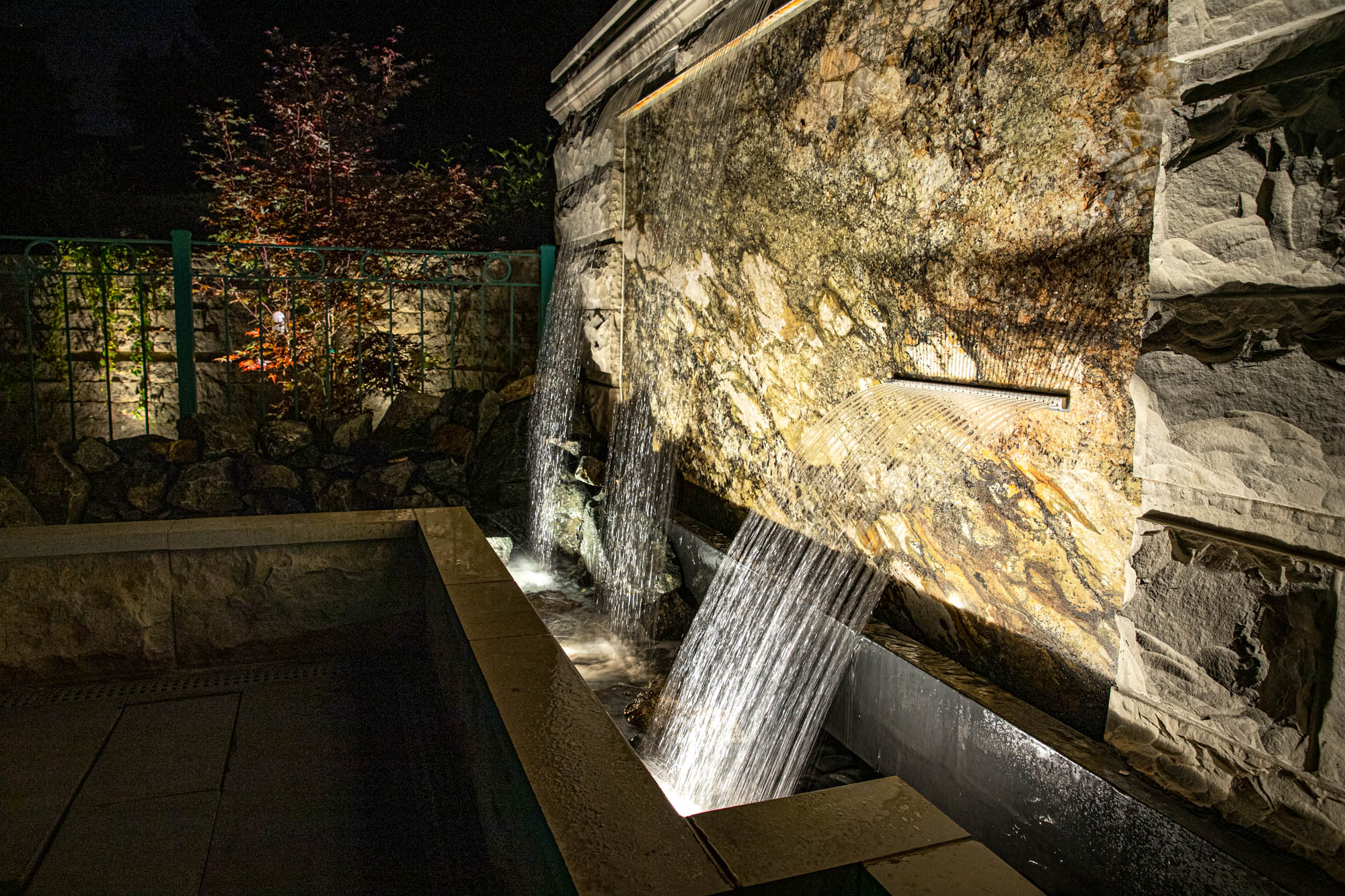 brookfield landscape lighting night owl retaining wall stone bench waterfall feature