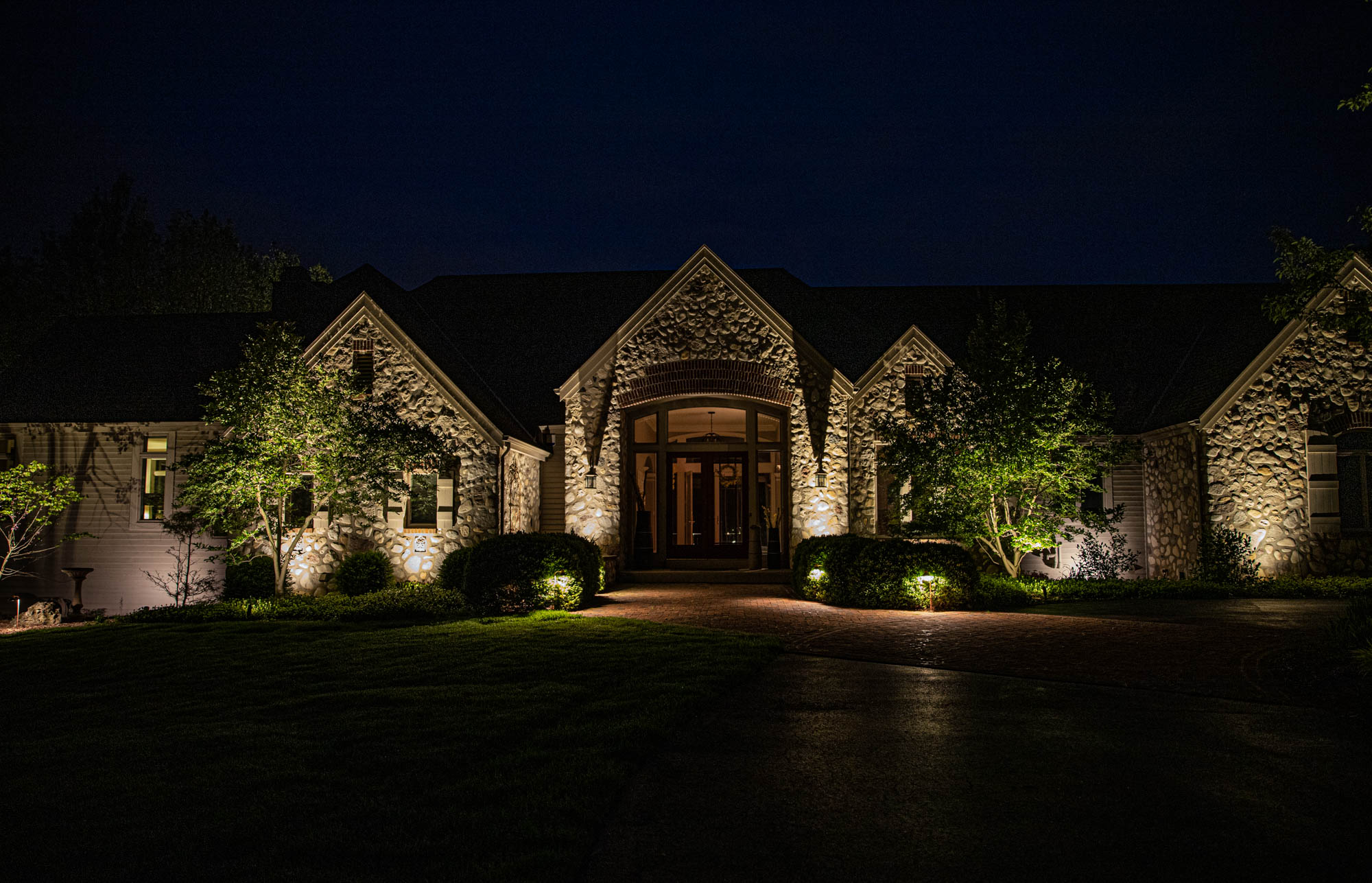 delafield landscape outdoor lighting night owl home security residential stone entry light design