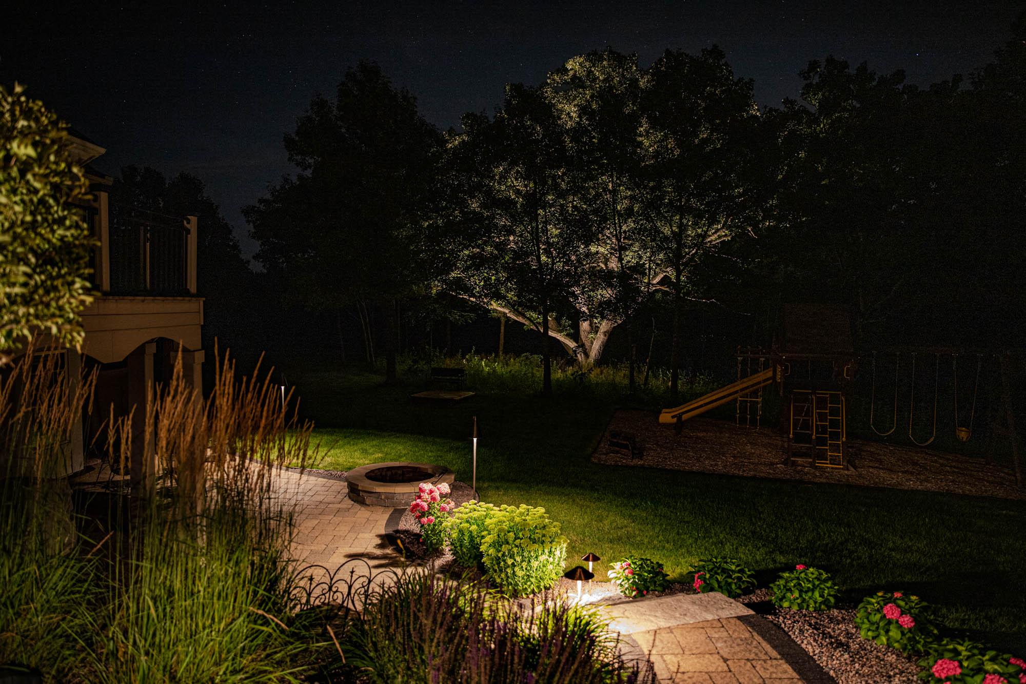 mukwonago landscape outdoor lighting night owl mature tree playground walkway steps path lights landscape plants