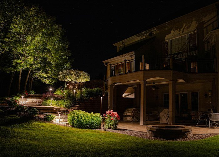 how to light up your backyard hardscape deck patio and steps with professional landscaping