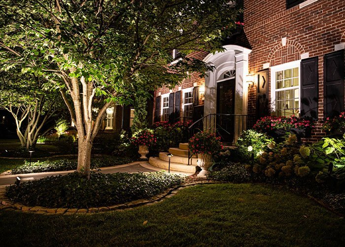 residential home landscape lighting system on wisconsin brick home