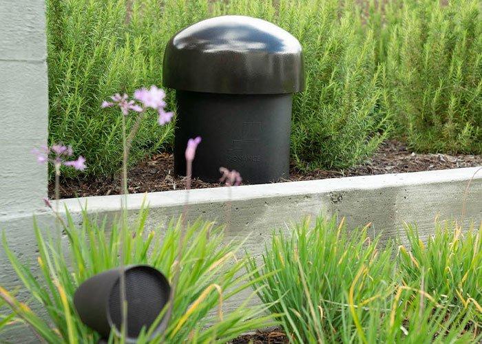 speaker and subwoofer hidden in landscape outdoor garden